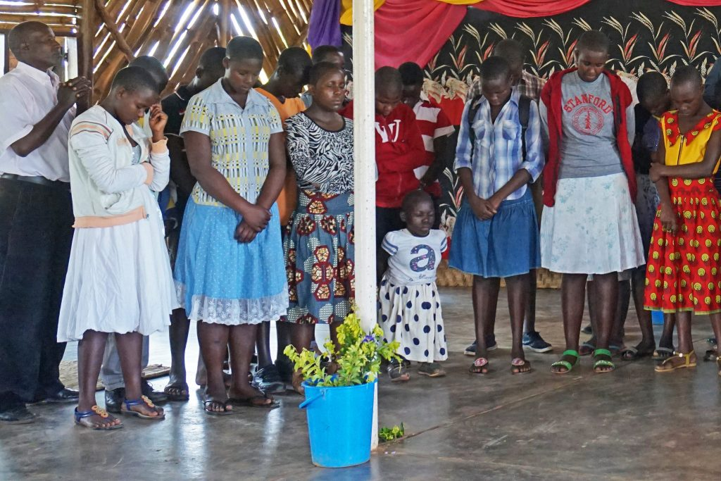 70  Praying for  Senior 7  Students