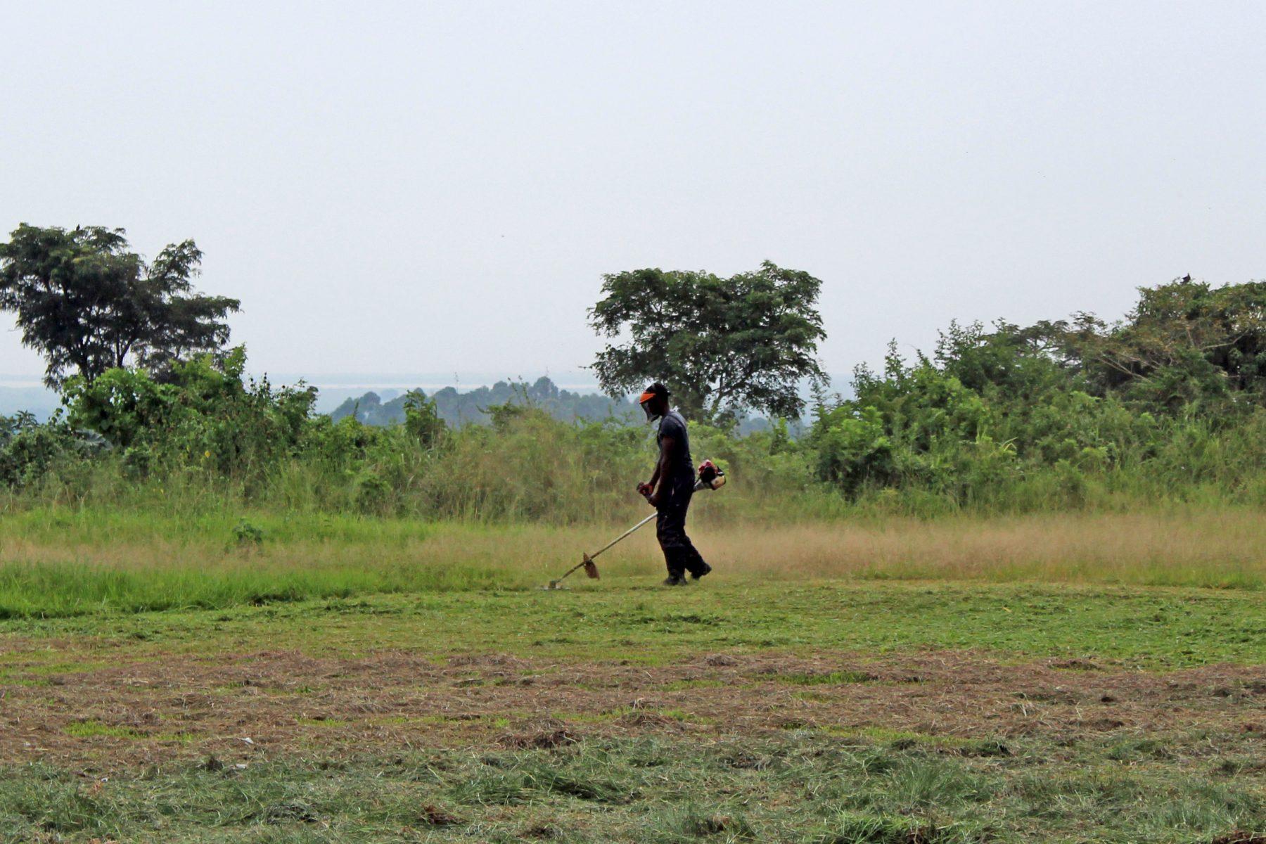 An EWCV High School Student Cutting Grass
