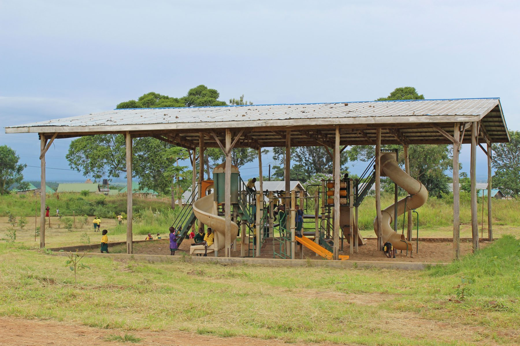 Children Playing on EWCV Covered Play Structure